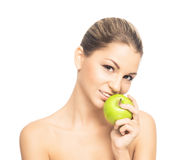 Portrait of a young woman eating an apple Stock Images