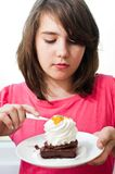Portrait of young woman eating cake isolated on wh Royalty Free Stock Photography