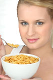 Portrait of a young woman eating cereals Royalty Free Stock Photos