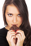 Portrait of young  woman eating chocolate Stock Images