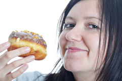 Portrait of a young woman eating a donut Royalty Free Stock Image
