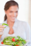 Portrait of a young woman eating a salad Royalty Free Stock Photo