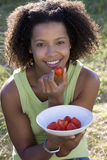 Portrait of young woman eating strawberry Royalty Free Stock Image