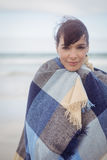 Portrait of young woman with eays closed wrapped in blanket Stock Image