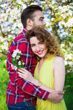 Portrait of young woman embracing her boyfriend in garden Royalty Free Stock Photography