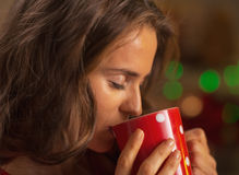 Portrait of young woman enjoying cup of hot chocolate Royalty Free Stock Photo