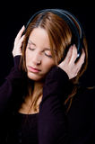 Portrait of young woman enjoying music Royalty Free Stock Photography