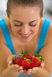 Portrait of young woman enjoying strawberries Stock Photo