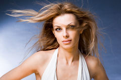 Portrait young woman enjoying the wind. Portrait of a beautiful young woman enjoying the wind. In the studio Royalty Free Stock Photography