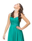 Portrait of young woman in evening green dress Stock Photo