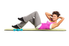 Woman doing exercise stock photos