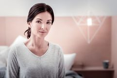 Portrait of young woman expressing calmness. Tranquility. Portrait of young woman looking at you while expressing calmness on her face stock photography