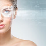 Portrait of a young woman with an eye-hologram Royalty Free Stock Photos