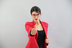 Portrait of young woman with eyeglasses with thumbs up isolated Royalty Free Stock Images