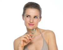 Portrait of young woman with eyelash curler Royalty Free Stock Photos