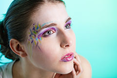 Portrait of young woman with face art Royalty Free Stock Photo
