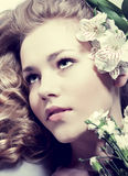 Portrait young woman face with flowers Royalty Free Stock Image