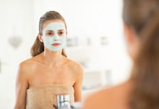 Portrait of young woman with facial cosmetic mask Royalty Free Stock Photography