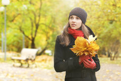 Portrait of a young woman with fallen leaves Royalty Free Stock Photos