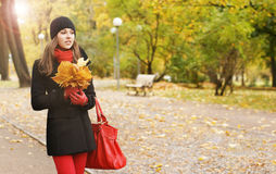 Portrait of a young woman with fallen leaves Stock Photo