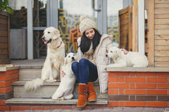 Portrait of the young woman with favourite dogs Royalty Free Stock Images