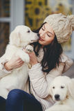 Portrait of the young woman with favourite dogs Stock Image