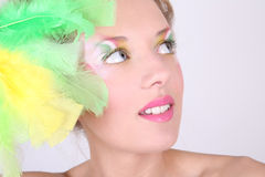 Portrait of young woman with feathers Stock Photography