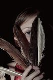Portrait of a young woman with feathers Stock Image