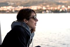 Portrait of Young woman on ferry boat. looking at distance Stock Image