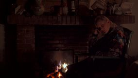 Woman in a fireplace stock video