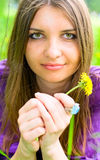 Portrait of young woman with flower Stock Photography