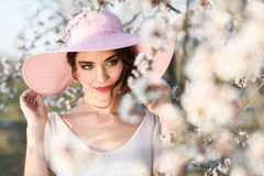 Portrait of young woman in the flowered garden in the spring tim Stock Photos