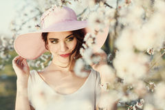 Portrait of young woman in the flowered garden in the spring tim Royalty Free Stock Images