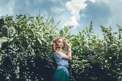 Woman in spring blossom. Young naturally beautiful woman near th stock photos