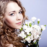 Portrait of a young woman with flowers Royalty Free Stock Photo