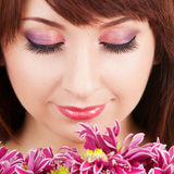 Portrait of a young woman with flowers Royalty Free Stock Image