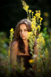 Portrait of a young woman on flowers field Stock Photo