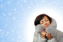 Portrait of young woman in fluffy hood Royalty Free Stock Photos