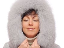 Portrait of young woman in fluffy hood Stock Photo
