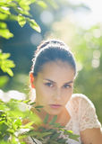 Portrait of young woman in foliage Royalty Free Stock Images