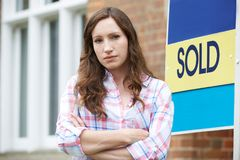Portrait Of Young Woman Forced To Sell Home Through Financial Pr Stock Images