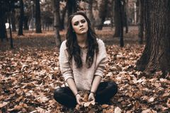 Portrait of a Young Woman in Forest Royalty Free Stock Images