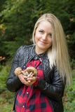 Portrait of a young woman in a forest with a mushroom c Royalty Free Stock Images