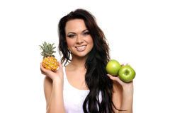 Portrait of a young woman with fresh fruits Stock Photography