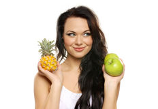 Portrait of a young woman with fresh fruits Royalty Free Stock Images