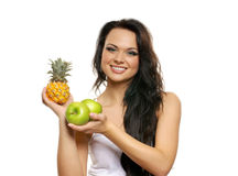 Portrait of a young woman with fresh fruits Stock Photo