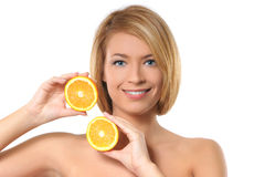 Portrait of a young woman with fresh oranges Royalty Free Stock Photos