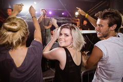 Portrait of young woman with friends enjoying music concert Stock Images