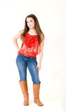 Portrait Young Woman full body. Young girl blue jeans, long dark hair, red top, brown boots Royalty Free Stock Image