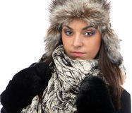 Portrait of young woman in fur cap Stock Photos